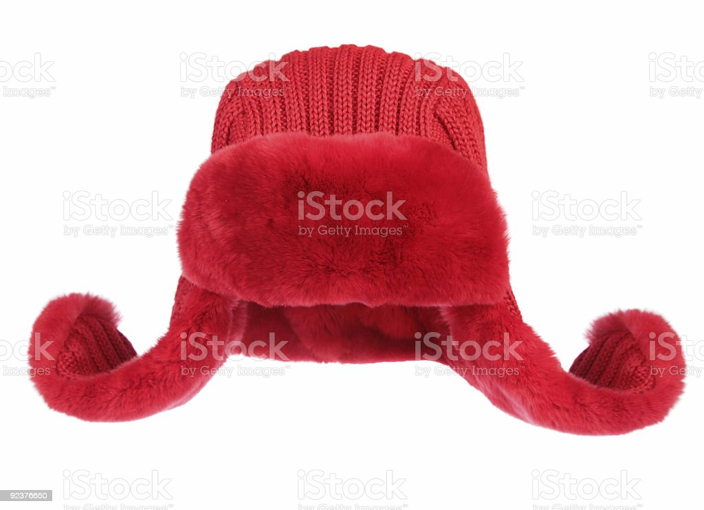 Red fur cap on a white background royalty-free stock photo
