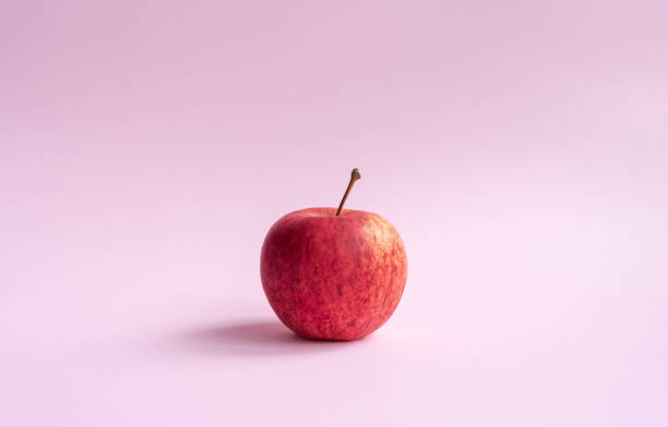 Red gala apple on pink background stock photo