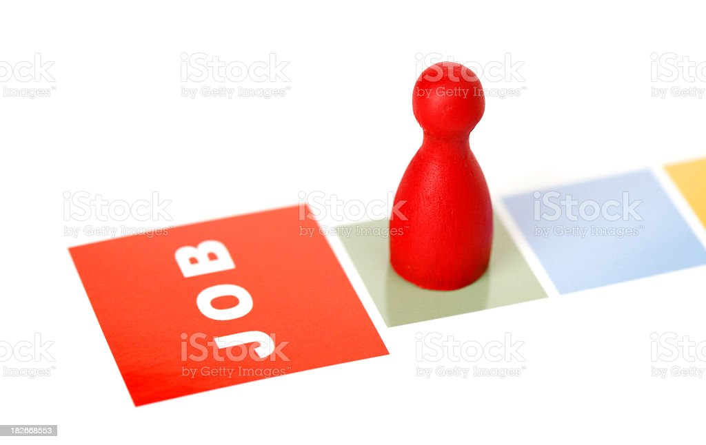 Red game piece moving towards new job on game board royalty-free stock photo