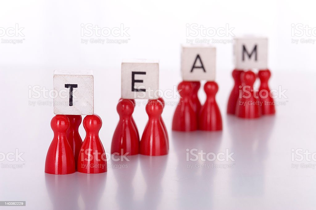 Red game tokens holding up the word TEAM royalty-free stock photo