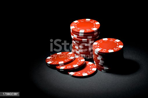 Stacks of red playing chips.