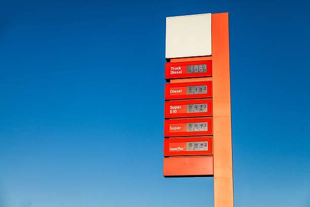 red gas station price sign stock photo