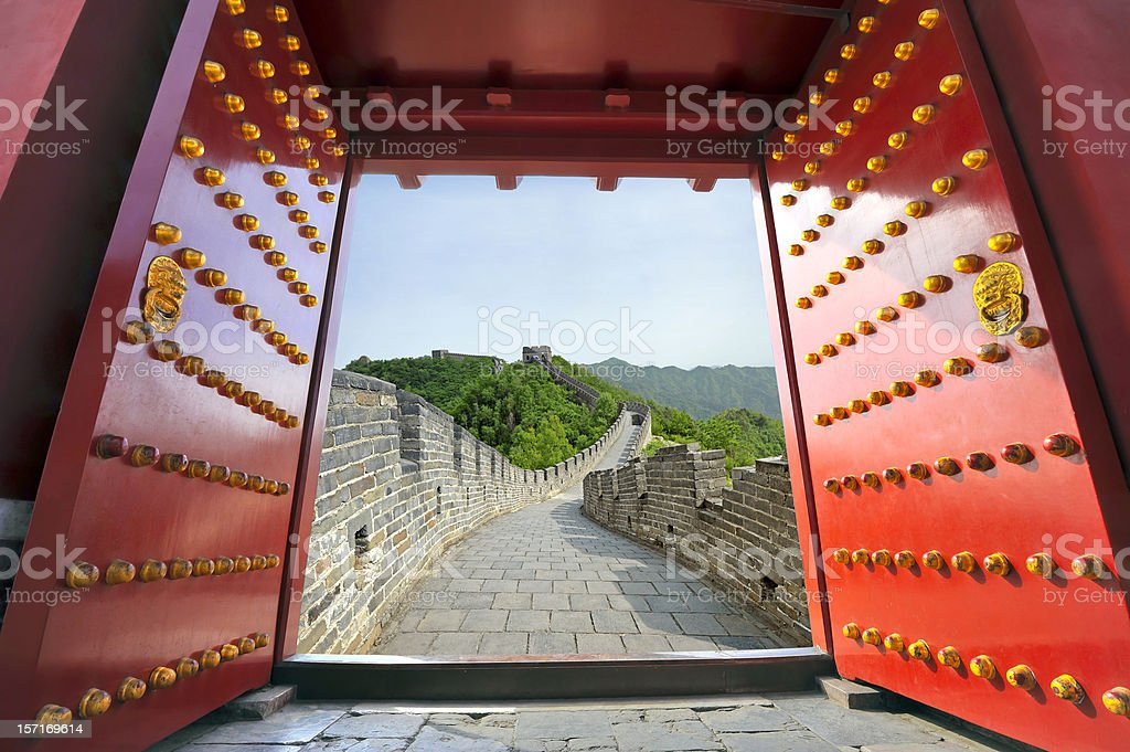 Red gate opening to the Great Wall of China stock photo