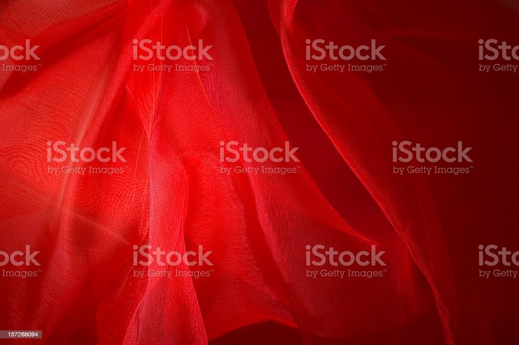 Red gauzy background with varied shades of red like flames stock photo