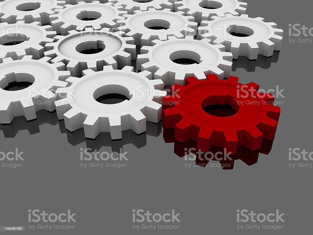 Red gear is leading a group of gears stock photo