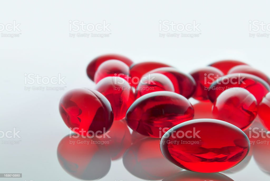 Red gel capsules stock photo