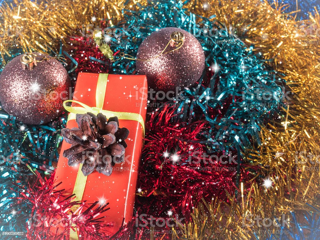 red gift among Christmas tinsel,  Vintage Стоковые фото Стоковая фотография