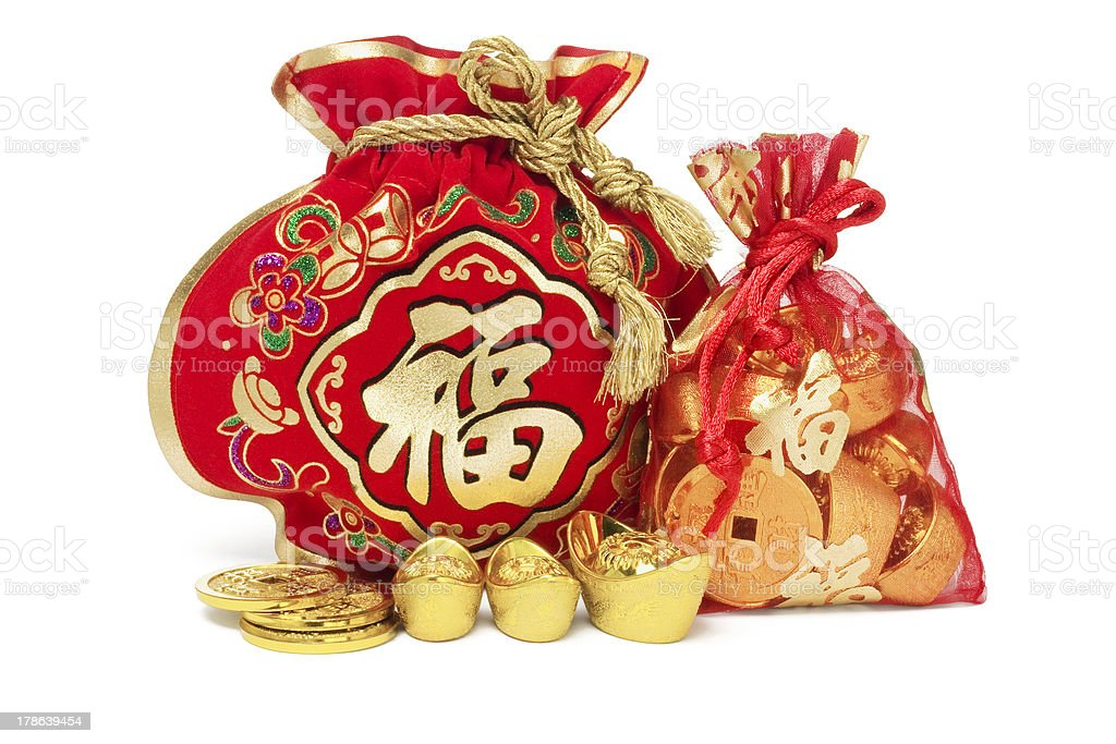 Red Gift Bags and Gold Ingots royalty-free stock photo