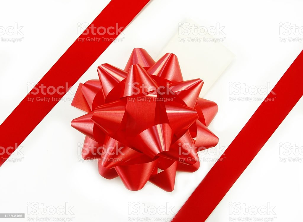 Red Gift Bow and Tag on White Box stock photo