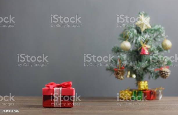 Red gift box and fir tree backgroundvariety objects on modern rustic picture id868331744?b=1&k=6&m=868331744&s=612x612&h=lcac7zzlqcxacl1pz2bfufx9c vgxx5f f7l7 d38qk=