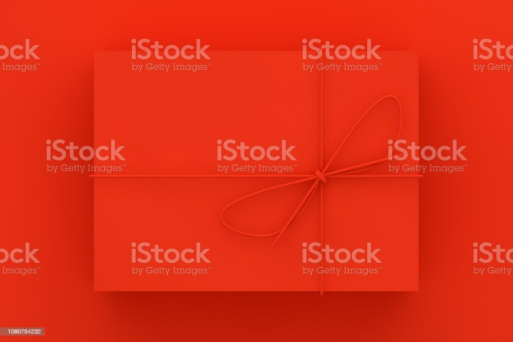Red Gift Box on Red Background stock photo