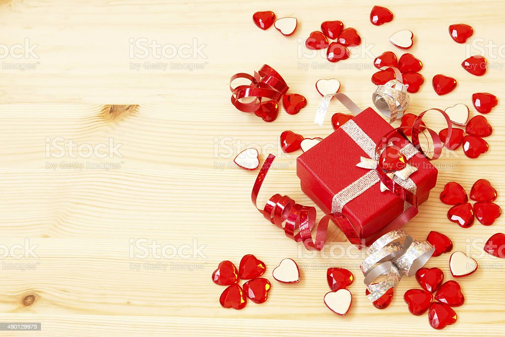 red gift box, ribbons and valentine's hearts royalty-free stock photo