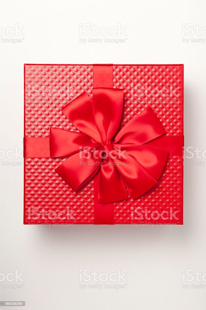 Red gift box tied with red ribbon and large bow stock photo