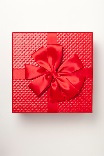 Red Gift Box Tied With Red Ribbon And Large Bow Stock Photo - Download Image Now