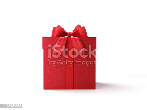 Red gift box tied with red ribbon on red background. Horizontal composition with copy space. Great use for Christmas and Valentine's Day related gift concepts.