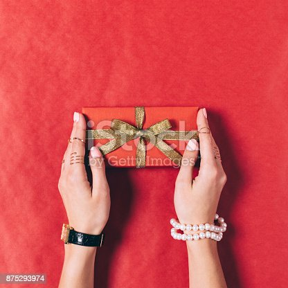 istock Red gift box with golden ribbon 875293974