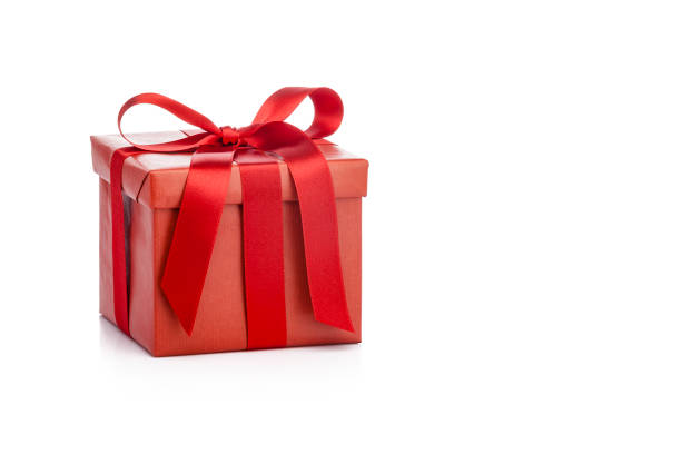 red gift box with red ribbon isolated on white background - gift стоковые фото и изображения