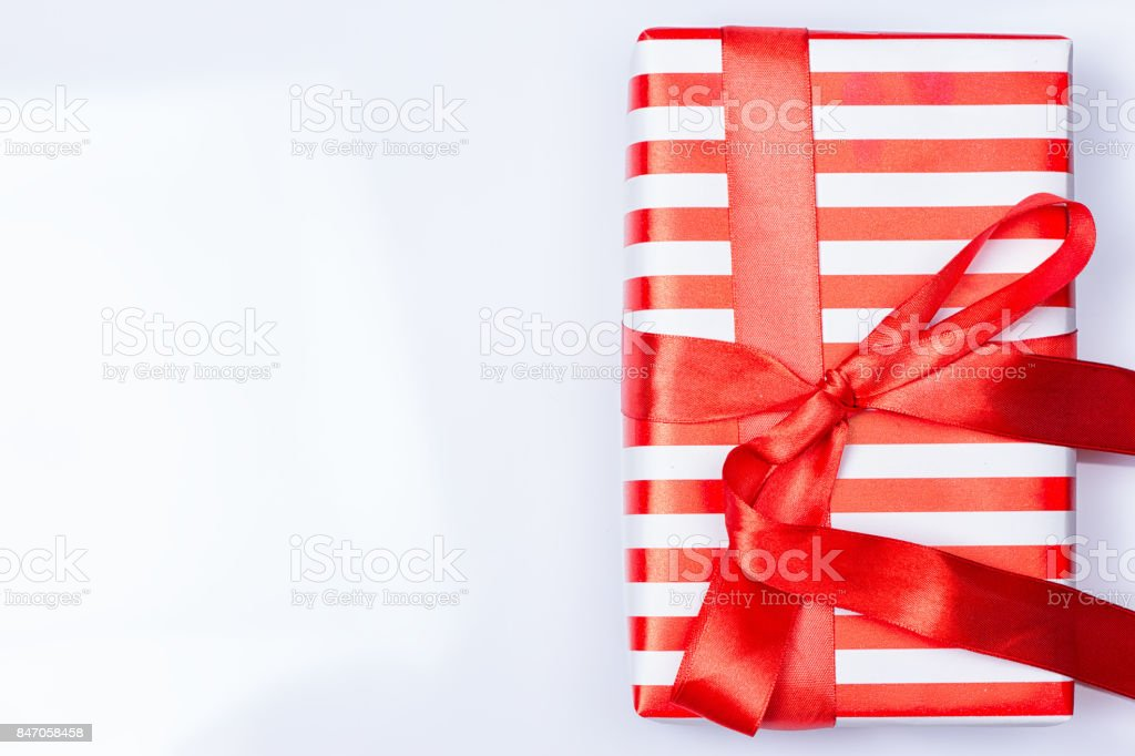 Red gift box with ribbon stock photo