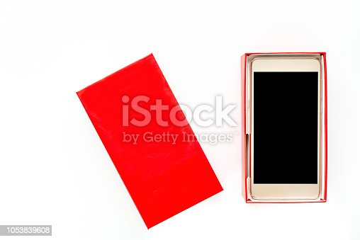 1161116588istockphoto Red gift box with smartphone, new package with smart mobile phone, mockup 1053839608
