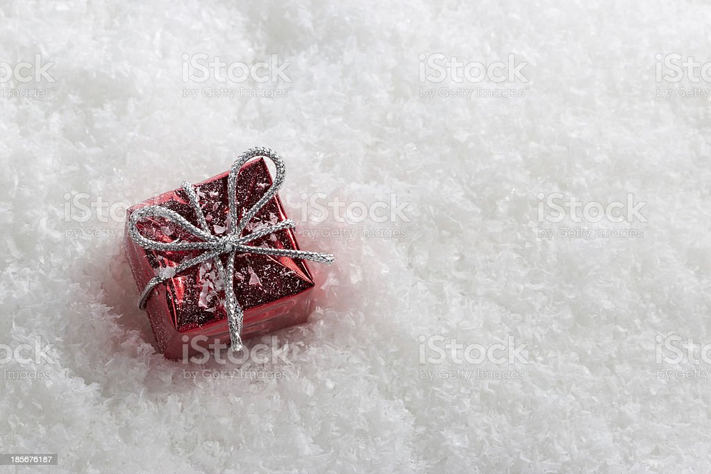 Red gift boxes in snow. royalty-free stock photo
