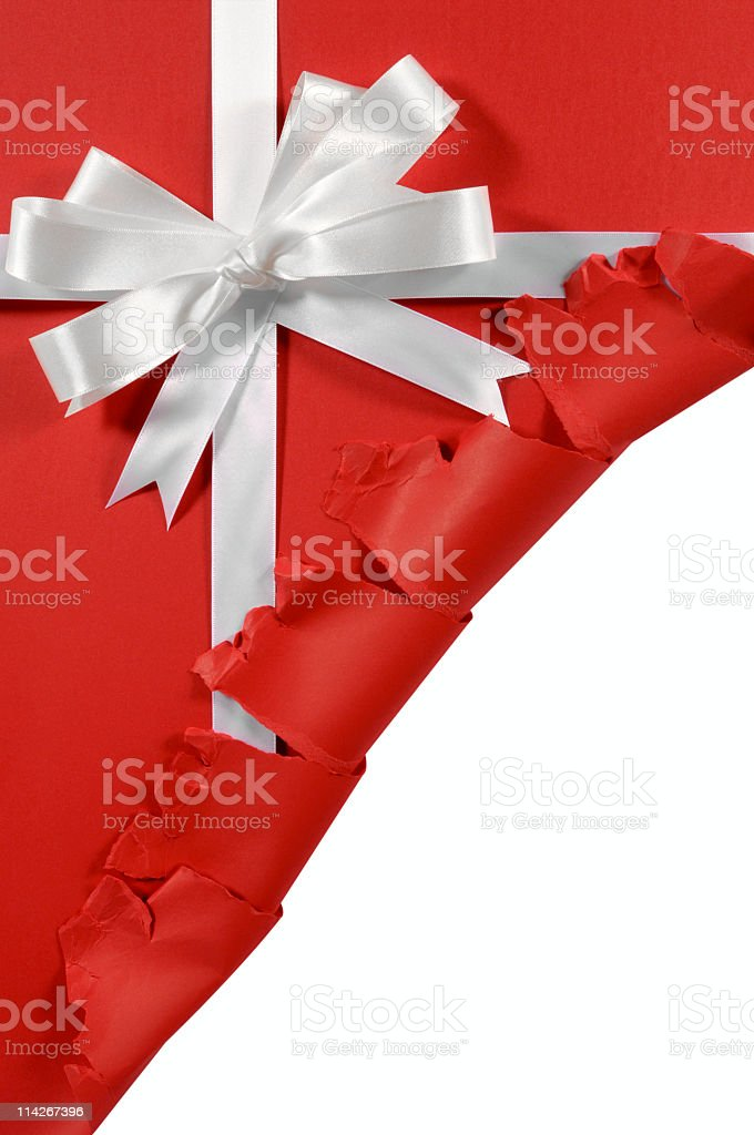 Red gift envelope being torn upwards to reveal white space stock photo