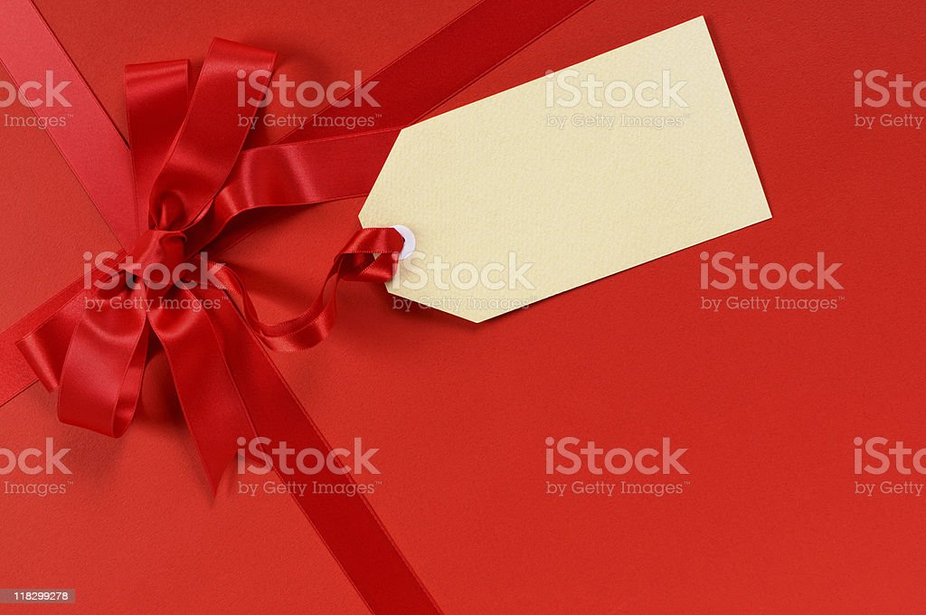 Red gift with tag royalty-free stock photo