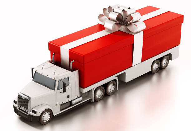 red giftbox wrapped with gold ribbon loaded at the back of cargo truck - topics stock photos and pictures