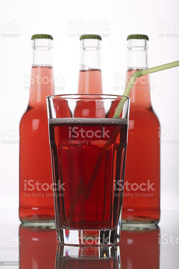 Red Glass and Bottles of Lemonade royalty-free stock photo