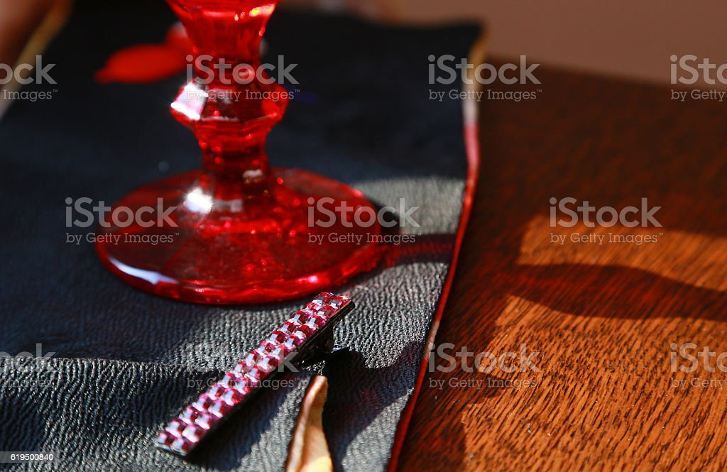 Red glass and tiepin stock photo