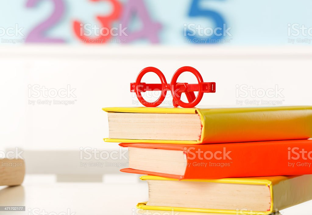 Red glasses on the books royalty-free stock photo
