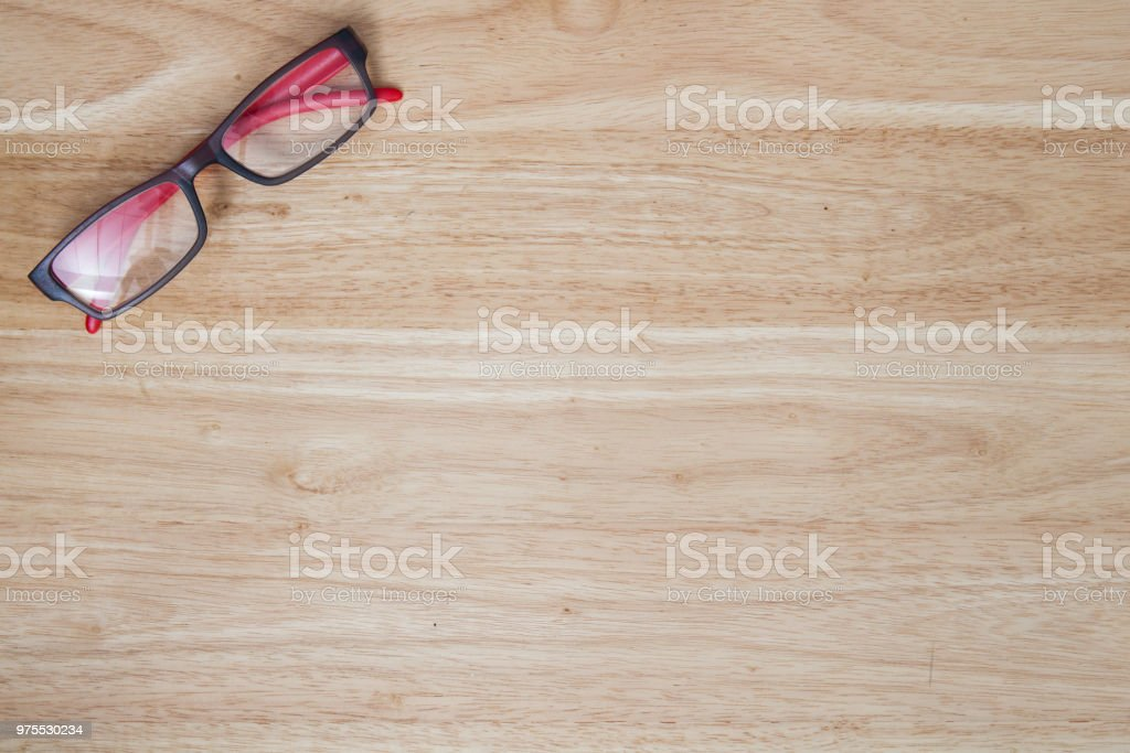 red glasses on wood table stock photo