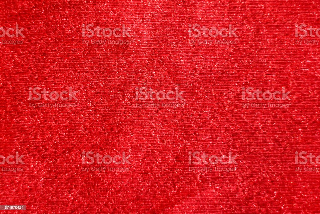Red glitter abstract festive background with blur bokeh stock photo