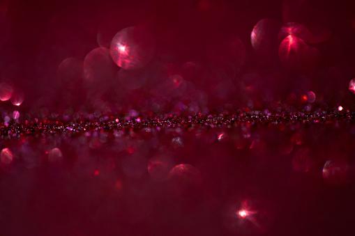 977706014 istock photo Red Glitter Background 1132839876