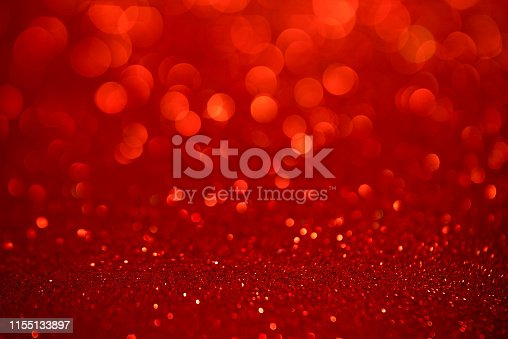 Red glitter christmas abstract background. Defocused sequin light.