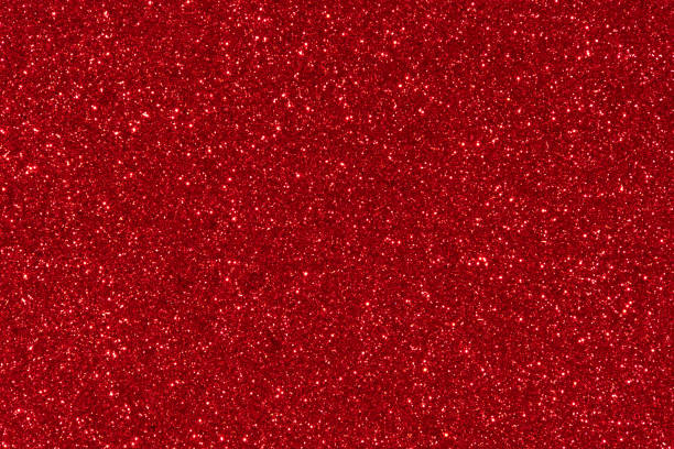 red glitter texture abstract background - scintillante foto e immagini stock