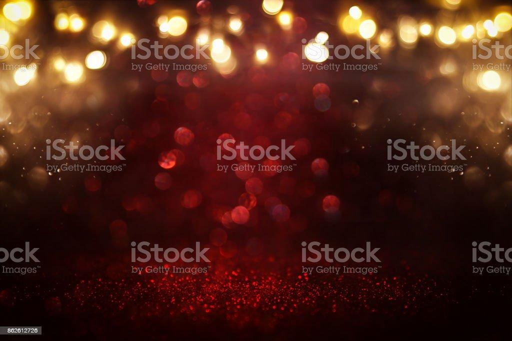 Red glitter vintage lights background. defocused stock photo