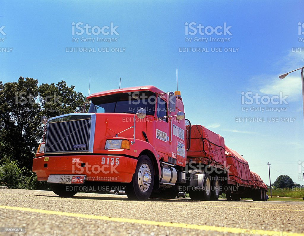 red gmc truck with trailer in parking lot stock photo