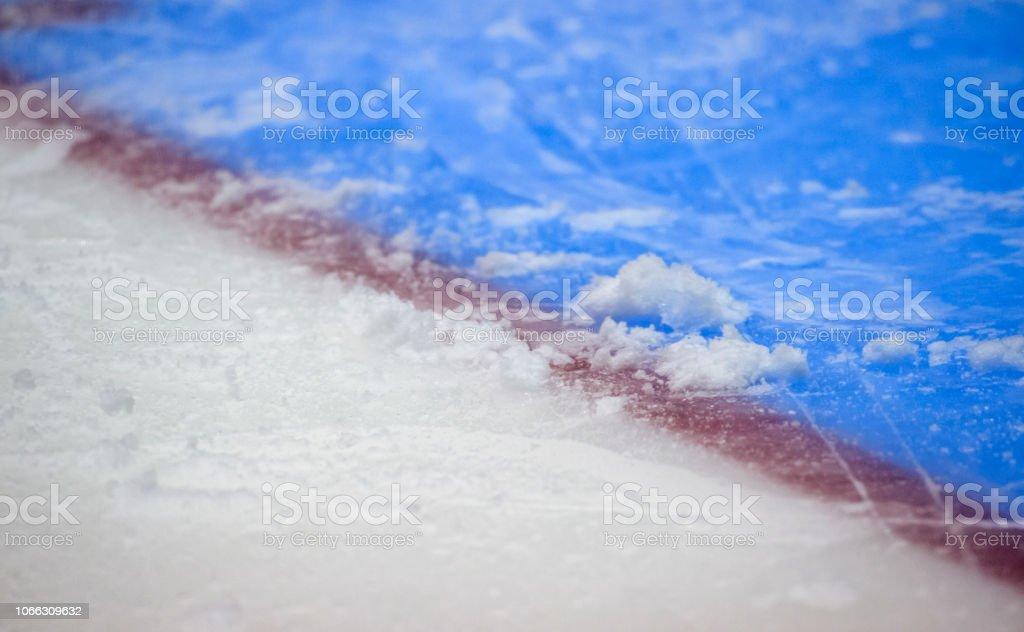 Red goal line on ice hockey rink. Winter sport