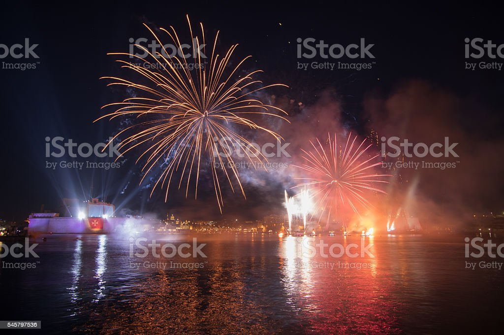 Red & Gold Fireworks over the Grand Harbour, Fort St. stock photo