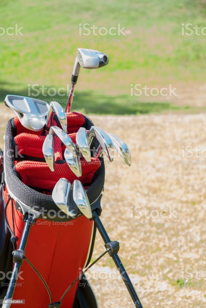 Red Golf Bag with Silver Golf Clubs