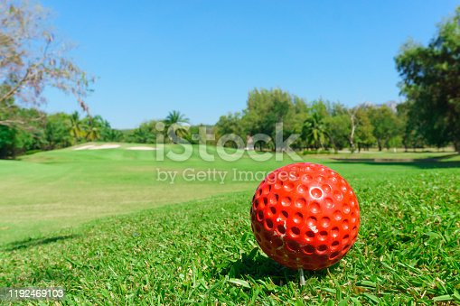 istock red golf ball on green 1192469103