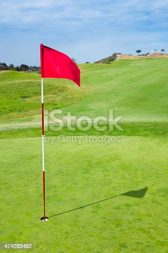 A red golf flag blowing in the wind. http://blog.michaelsvoboda.com/GolfBanner.jpg