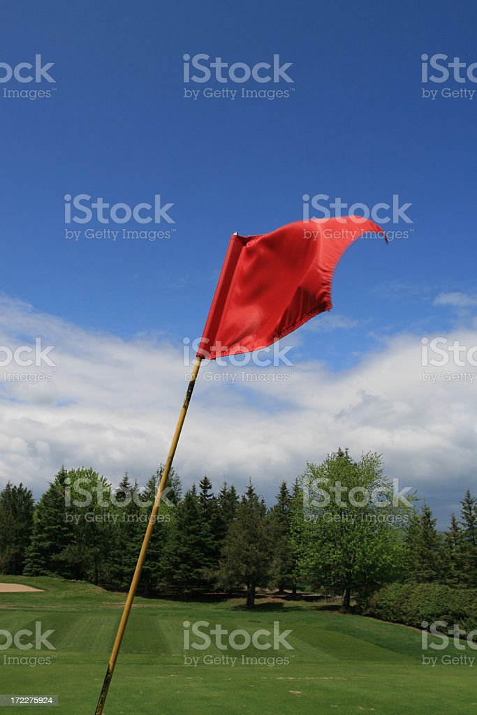 Red golf flag with blue sky royalty-free stock photo
