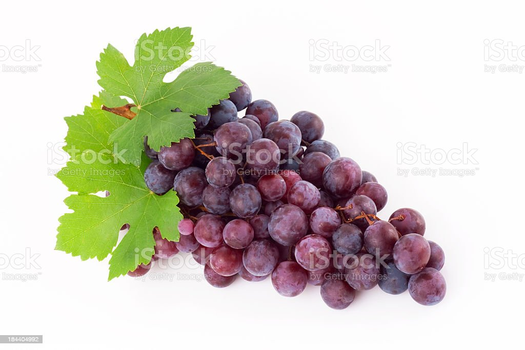Red grape with leaves on a white background stock photo