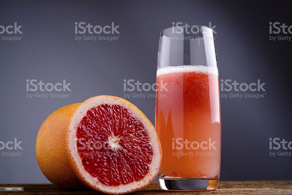 red grapefruit juice stock photo
