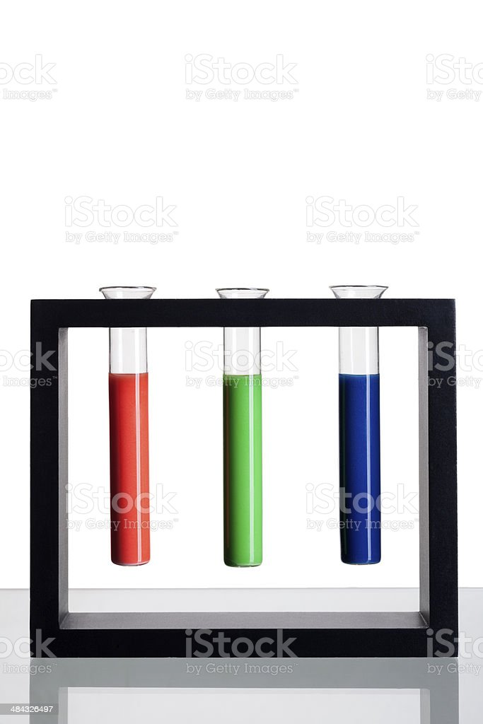 Red, green and blue test tube rack stock photo