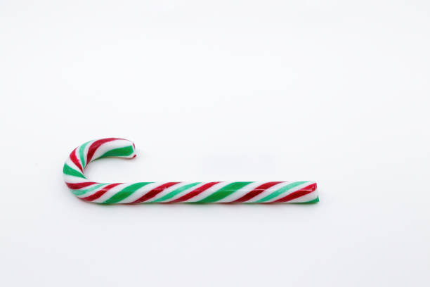 Red, Green and White candy cane Christmas decorations, concept of Holidays loading. Christmas composition. Christmas, winter, new year concept. Flat lay, top view, copy space. stock photo
