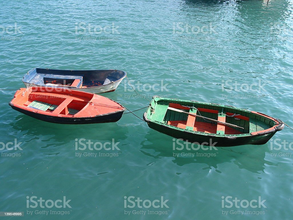 red green blue 3 wooden boats royalty-free stock photo