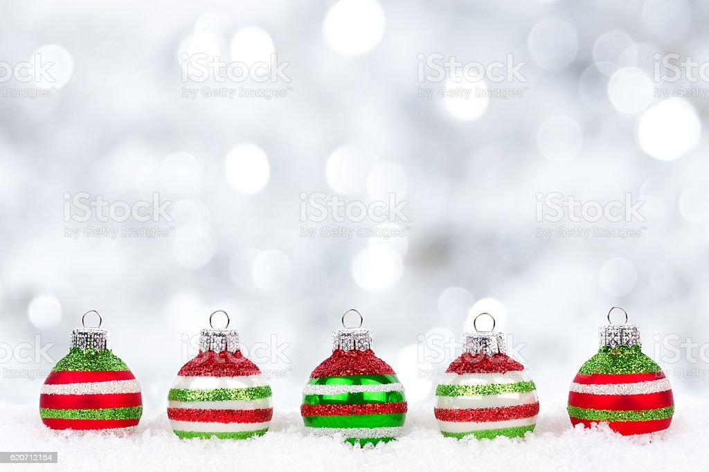 Christmas Ornaments Background.Red Green White Christmas Ornaments In Snow With Twinkling