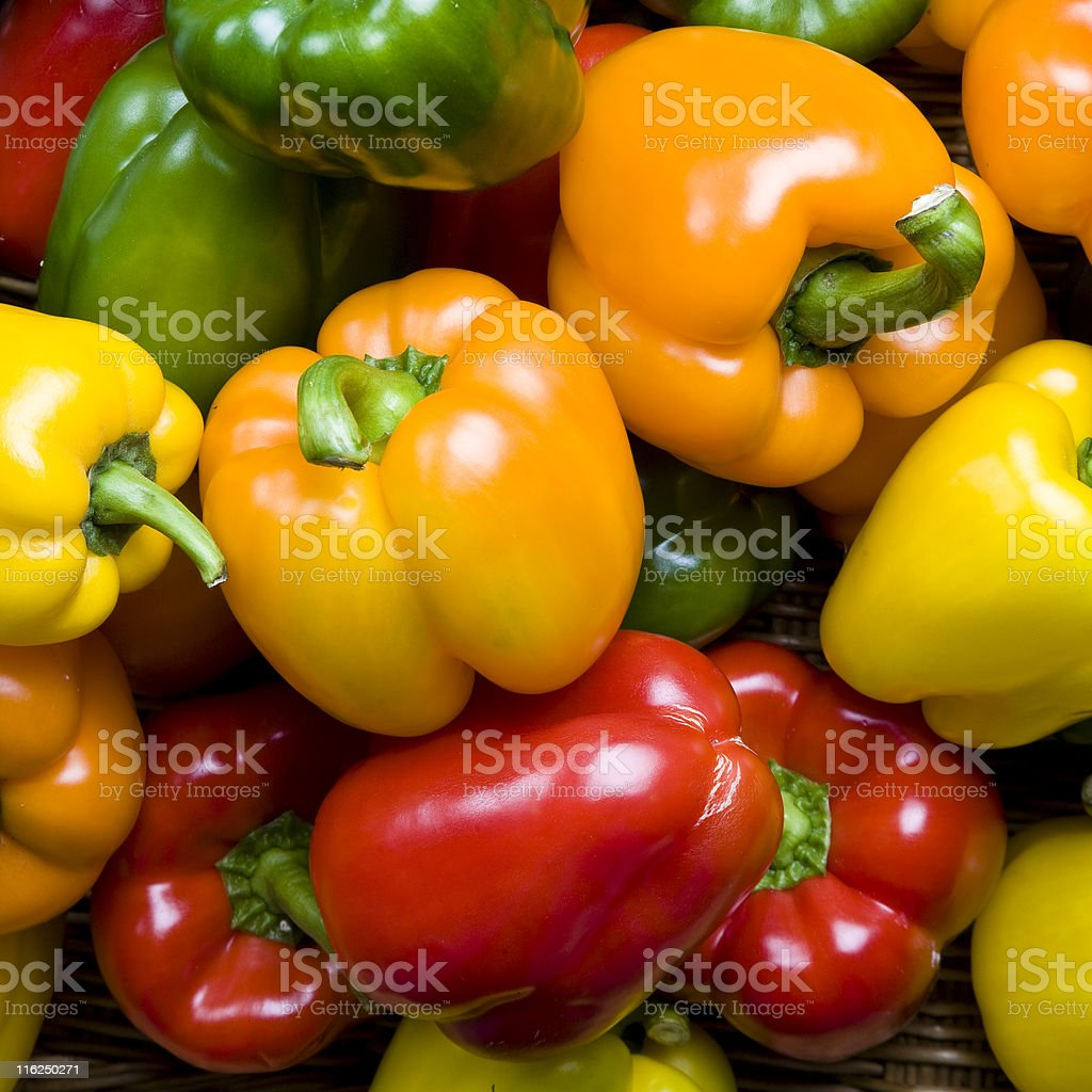 Red green yellow and orange peppers as a background stock photo